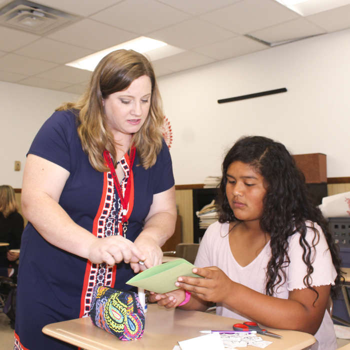 Mrs. Eveland helping student in classroom
