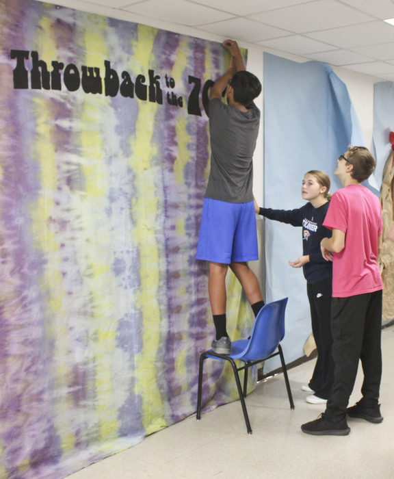 Students hanging wall art